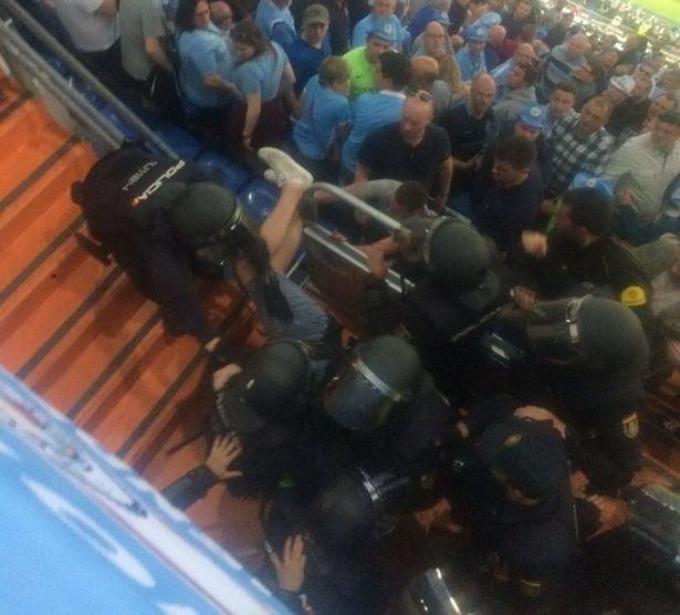 Man City fans fight Spanish police