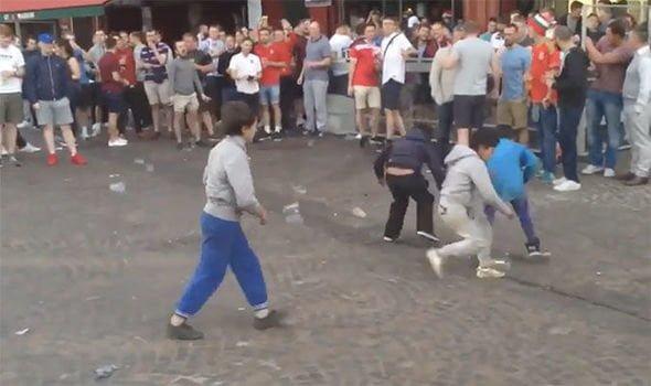 England fans mock child beggars